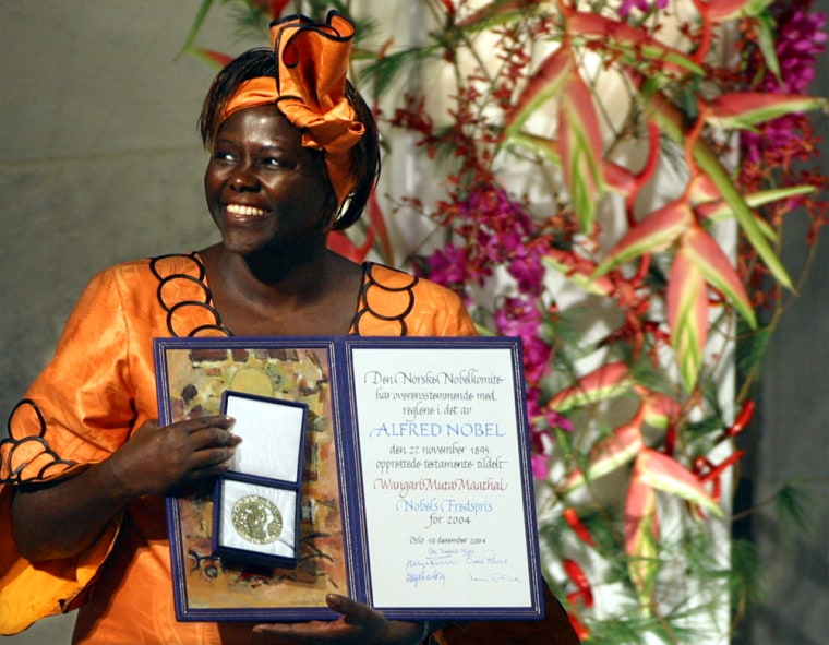 Nobel Peace Prize laureate Wangari Maathai holds her prize and certificate at Oslo City Hall on Friday.