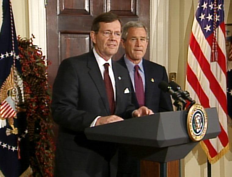 EPA chief Mike Leavitt speaks at the White House Monday as President Bush looks on.