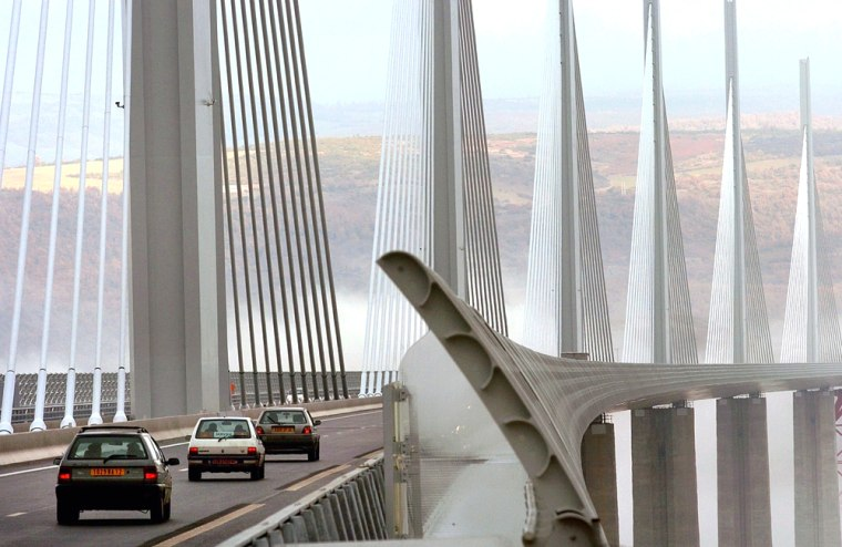 Traffic begins to cross the newly opened Millau Bridge in southern France on Thursday.