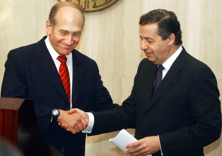 Israeli trade minister Ehud Olmert, left, shakes hands with his Egyptian counterpart Rashid Mohamed Rashid on Tuesday in Cairo.