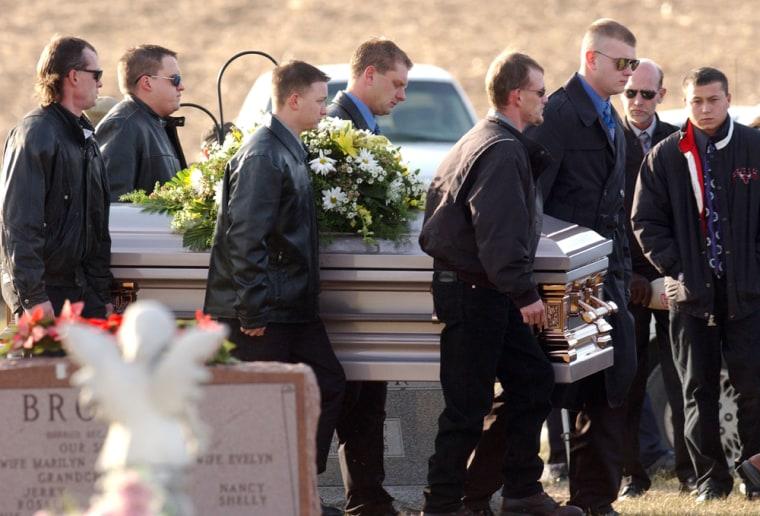 Pall bearers carry the casket of murder victim Bobbie Jo Stinnett in Skidmore