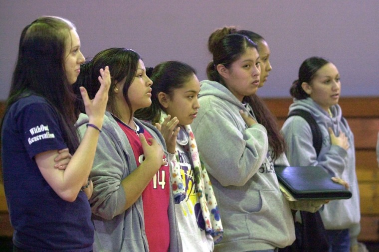 "Nixyaawii Charter School students attend ""protocol,"" a gathering of all students and teachers where announcements and issues are discussed at the start and end of each school day, in Mission, Ore, on Dec. 2."