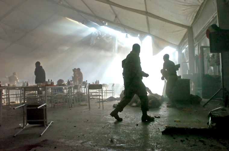 A hole in the roof of a tent lights smoke moments after a mortar attack at aforward operating base near Mosul on Tuesday.
