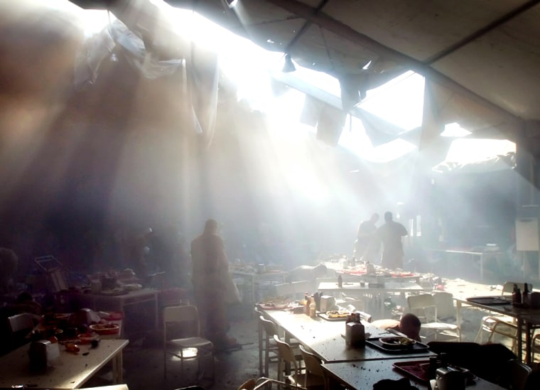 A cloud of smoke covers a dining area inside a mess tent at Forward Operating Base Marez in Mosul, Iraq, on Tuesday, moments after an apparent insurgent rocket attack.