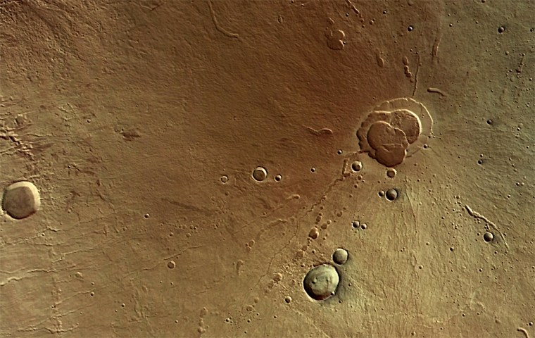 An image from the European Space Agency's Mars Express orbiter shows the Martian volcano known as Hecates Tholus, where repeated volcanic episodes have left overlapping lava flows.