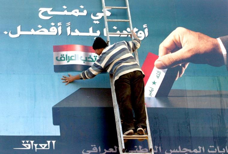 Billboard urging Iraqis to vote is prepared in Baghdad
