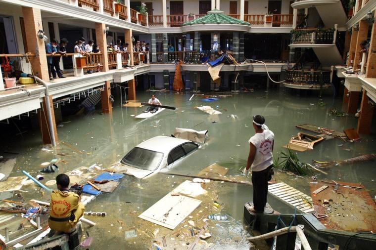 A cleanup crew surveys a flooded lobby at the Seapearl Beach Hotel along Patong Beach on Phuket Island on Tuesday.