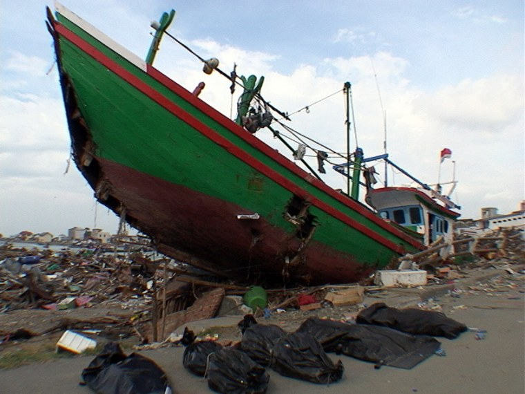 Jan. 4: Banda Aceh is filled with incongruous scenes, like this boat in a parking lot miles from the ocean.