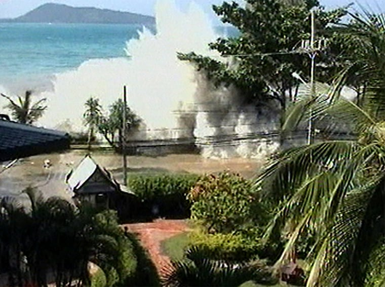 A still image made from an amateur video, shot by a British family vacationing at Patong Beach. Patong was one of the more heavily damaged beaches in Phuket. Maikho Beach was more fortunate.
