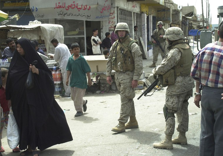 U.S. soldiers patrol in Mahmoudiya after an attack last April on a police chief linked to the U.S. authorities. One resident says locals don't tolerate U.S. forces in the Sunni city.