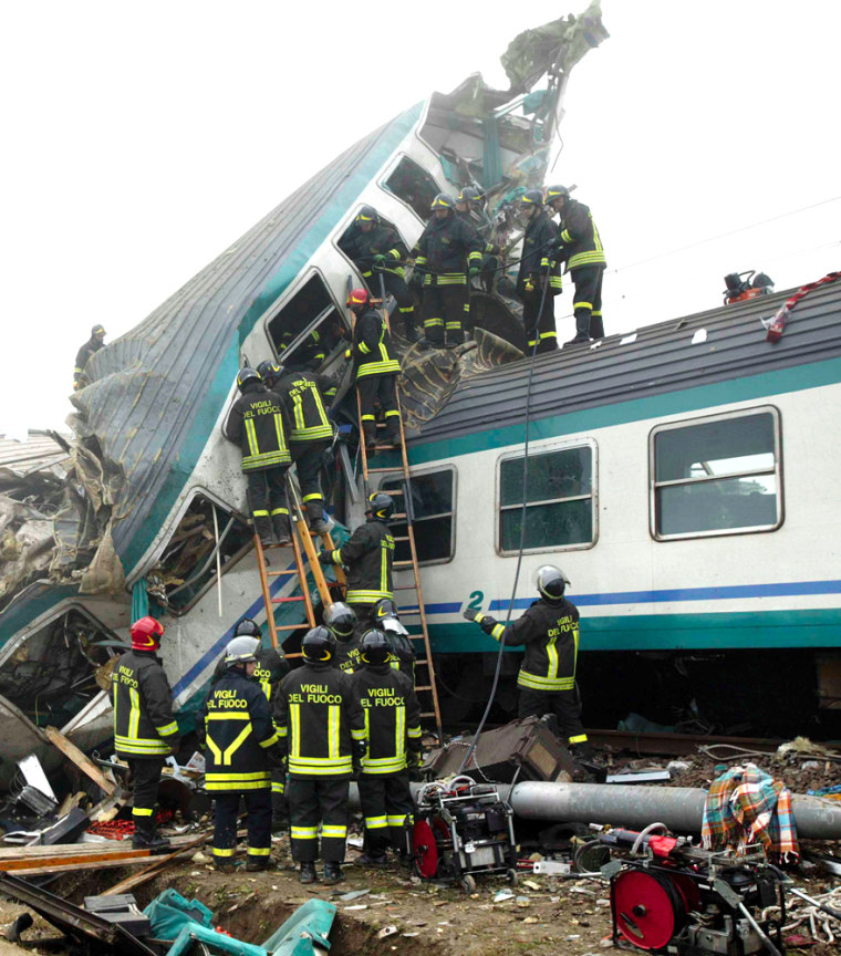 Firefighters work on the wreckage near Bologna innorthern Italy.