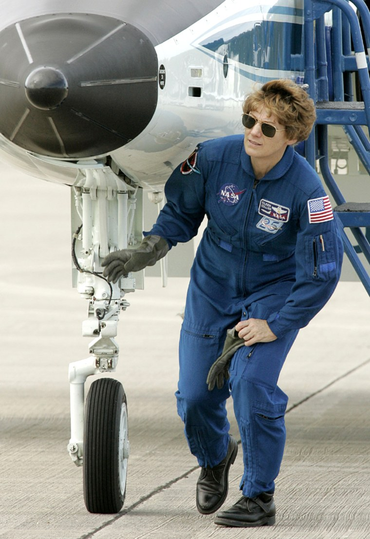 Shuttle Commander Eileen Collins checks out aircraft after press conference