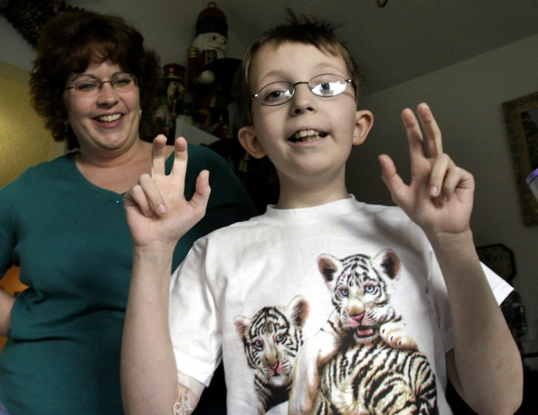 "Nine-year-old David Dingman-Grover, who has named his malignant brain tumor ""Frank"", is seen with his mother Tiffini, in Sterling, Va., on Tuesday."