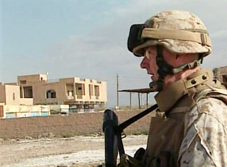 Chief Warrant Officer Jim Roussell on patrol in Yusufiya, Iraq.