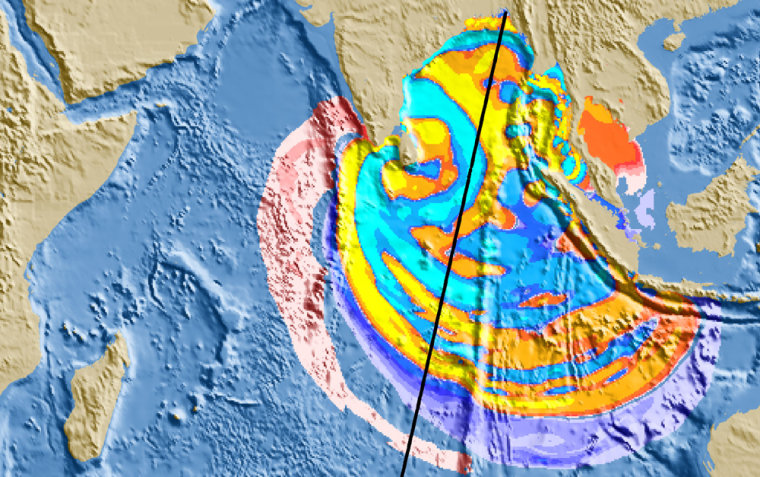 A color-coded map, based on data from four Earth-observing satellites, shows how the wave generated by the Sumatra quake spread out to varying heights three and a half hours after the seismic event.