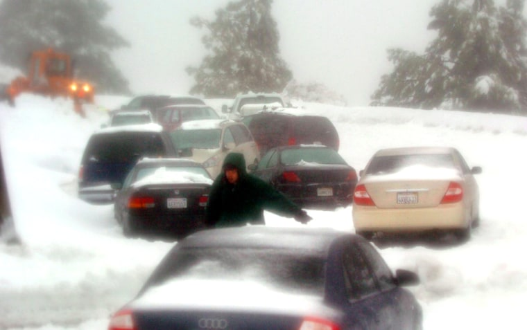 The snowfall wasn't welcomed by everyone, especially motorists who were stranded near Big Bear, Calif., on Saturday, when the storm closed all three major highways over the Sierra Nevada.