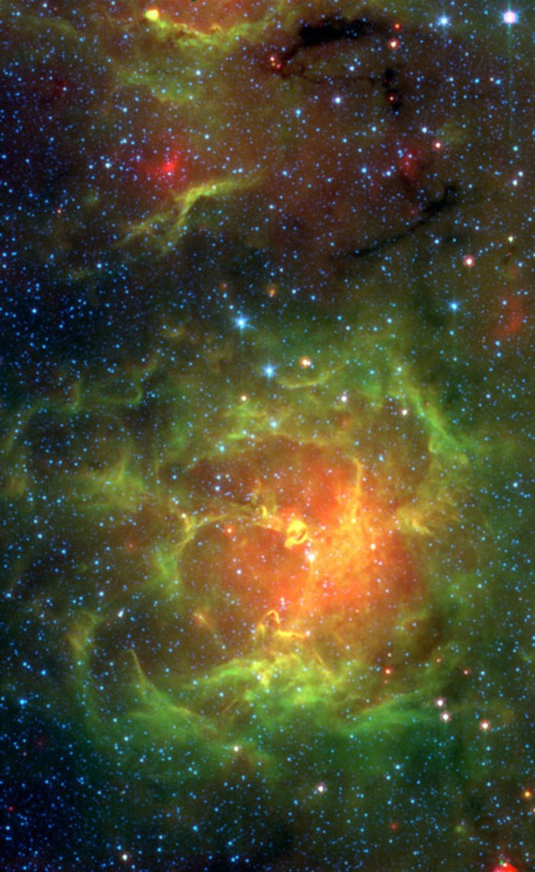 Massive stars-to-be in the Trifid Nebula are captured on the verge of erupting to life in this infrared image taken by the Spitzer Space Telescope.