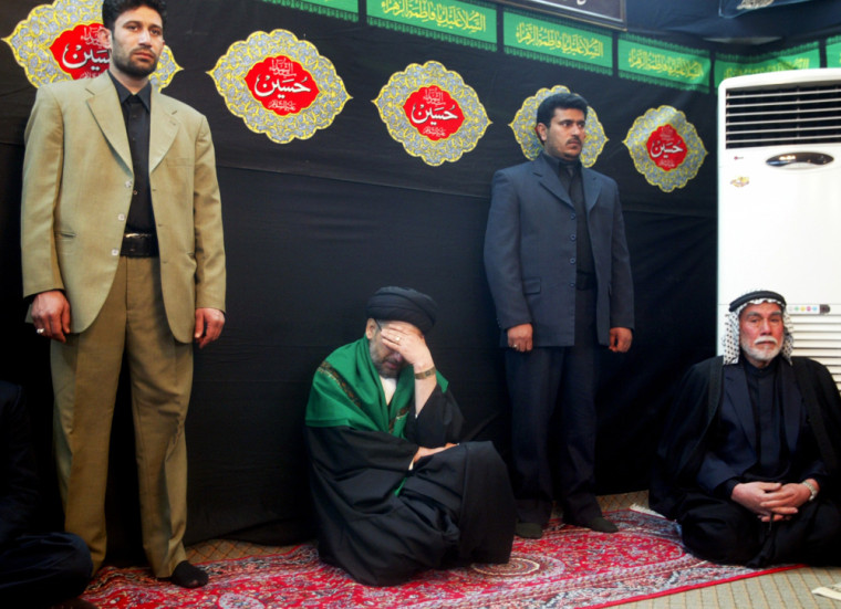 Iraqi Shi'ite leader weeps after hearing election results in Baghdad