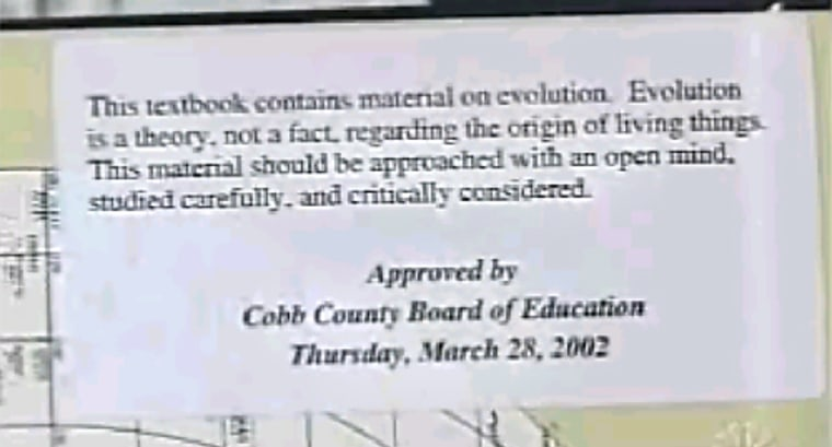 """The Cobb County Board of Education required these stickers to be pasted into biology textbooks,saying that evolution """"is a theory, not a fact, regarding the origin of living things. The material should be approached with an open mind, studied carefully, and critically considered."""""""