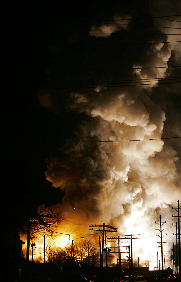 Smoke and flames pour from afire at the Advanced Magnesium Alloys Corp. recycling plant in Anderson, Ind. on Friday.