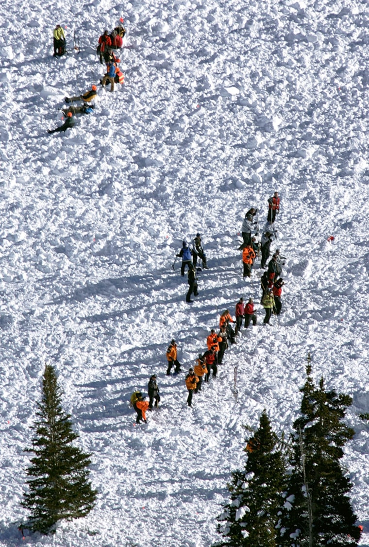 Rescue workers searched for bodies trapped under 30 feet of snow over the weekend in Utah's Wasatch Mountains.