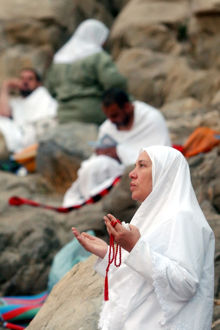 A pilgrim prays Wednesday at Jabal Al Rahma holy mountain, on Mount Arafat outside Mecca, Saudi Arabia.  More than two million pilgrims are expected to join the hajj, required at least once for every able bodied Muslim who can afford it.