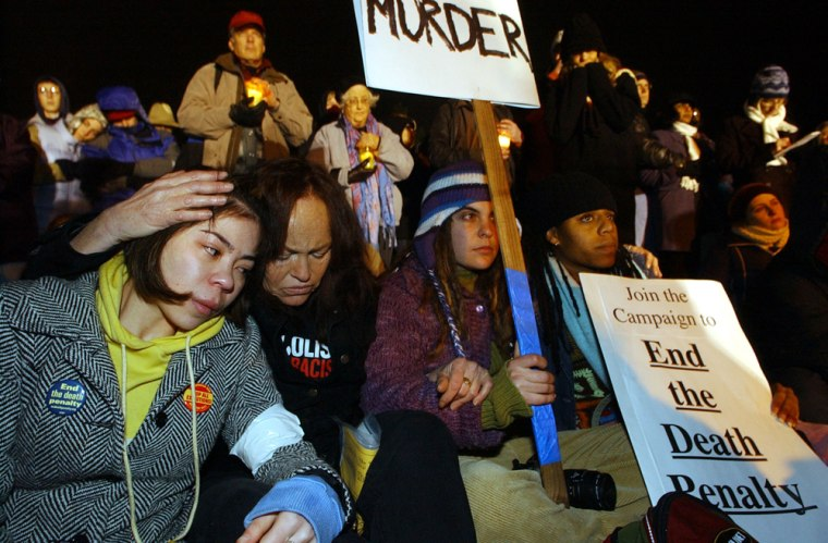 Protesters console each other as they wait for news of Donald Beardslee's execution outside San Quentin State Prison in San Quentin, Calif. on Wednesday.