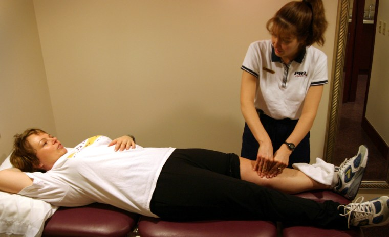 Each physical therapy session begins with therapist Bonnie Mangino massaging my left patellar tendon.