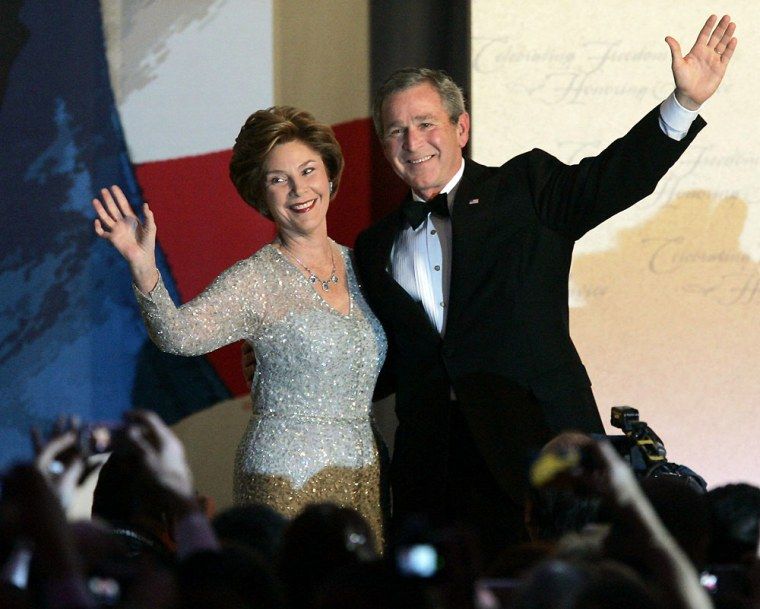 President Bush and first lady Laura Bush wave to the crowd after dancing at the Constitution Ball at the Washington Hilton Hotel during the 55th Presidential Inaugural celebration in Washington, D.C., Thursday.
