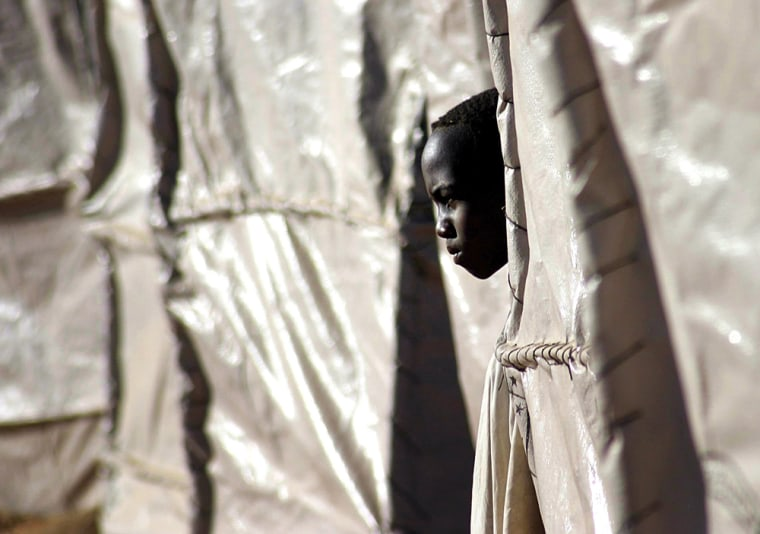 A displaced refugee boy looks out from his plastic tent in the Zam Zam refugee camp on the outskirts of El Fasher town, in the northern Darfur region of Sudan, on Nov. 22.