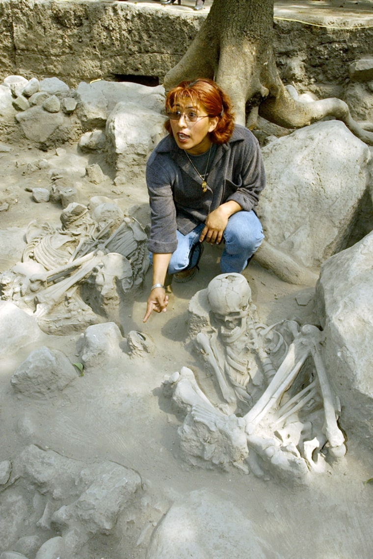 Archaeologist Rocio Morales examines the site where the remains were found on the edge of Mexico City's famous Chapultepec Park.