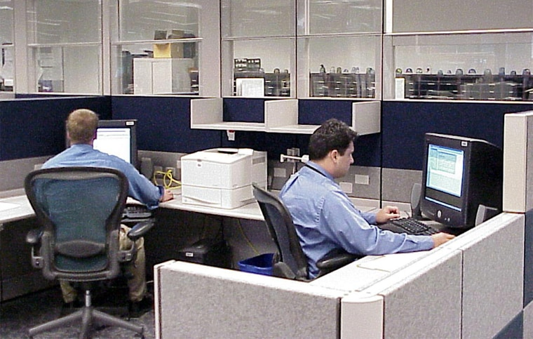 Federal law enforcement officersrespond to toll-free calls to the Department of Homeland Security in Williston, Vt., in July2003.The Government Accountability Officesaid Tuesdaythat information related to national security should be shared more effectively among agencies.
