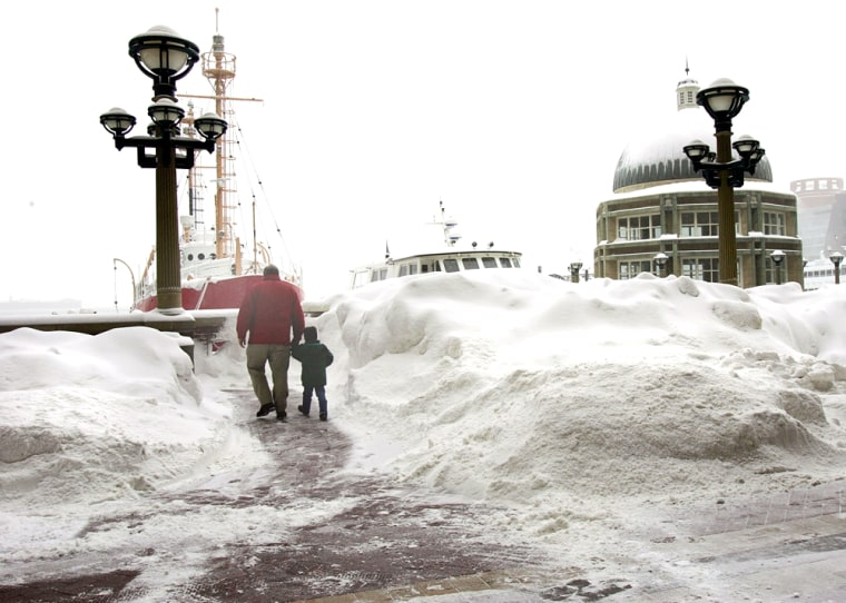 Snow keeps piling up in Boston, including Rowes Wharf on the waterfront, seen here on Wednesday.