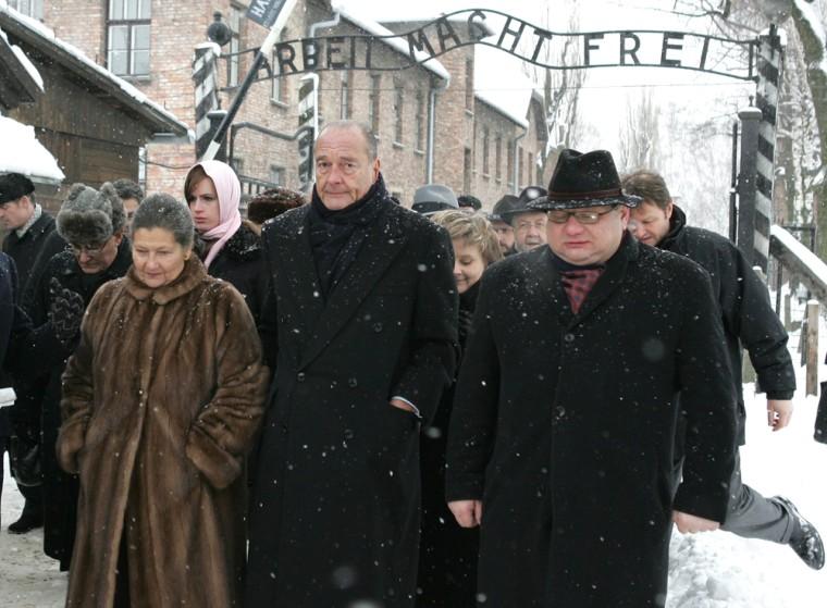 French President Chirac accompanied by Holocaust survivor and Polish Interior Minister Kalisz arrives in Auschwitz Birkenau