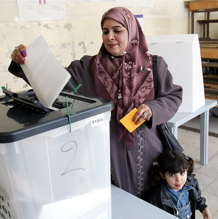 An Iraqi woman accompanied by her daughter casts her ballot at a polling station in Amman, Jordan, onSunday.