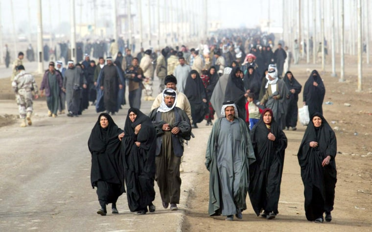 Thousands of Iraqis make a trip on foot to the town of Al Alamarato voteSunday after all car traffic was prohibited.
