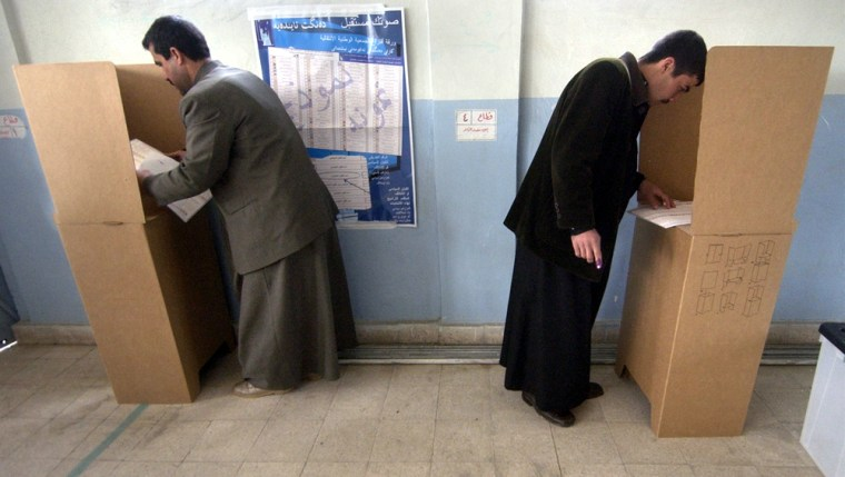 Iraqi men vote at a polling station in Mosul, Iraq, on Sunday.