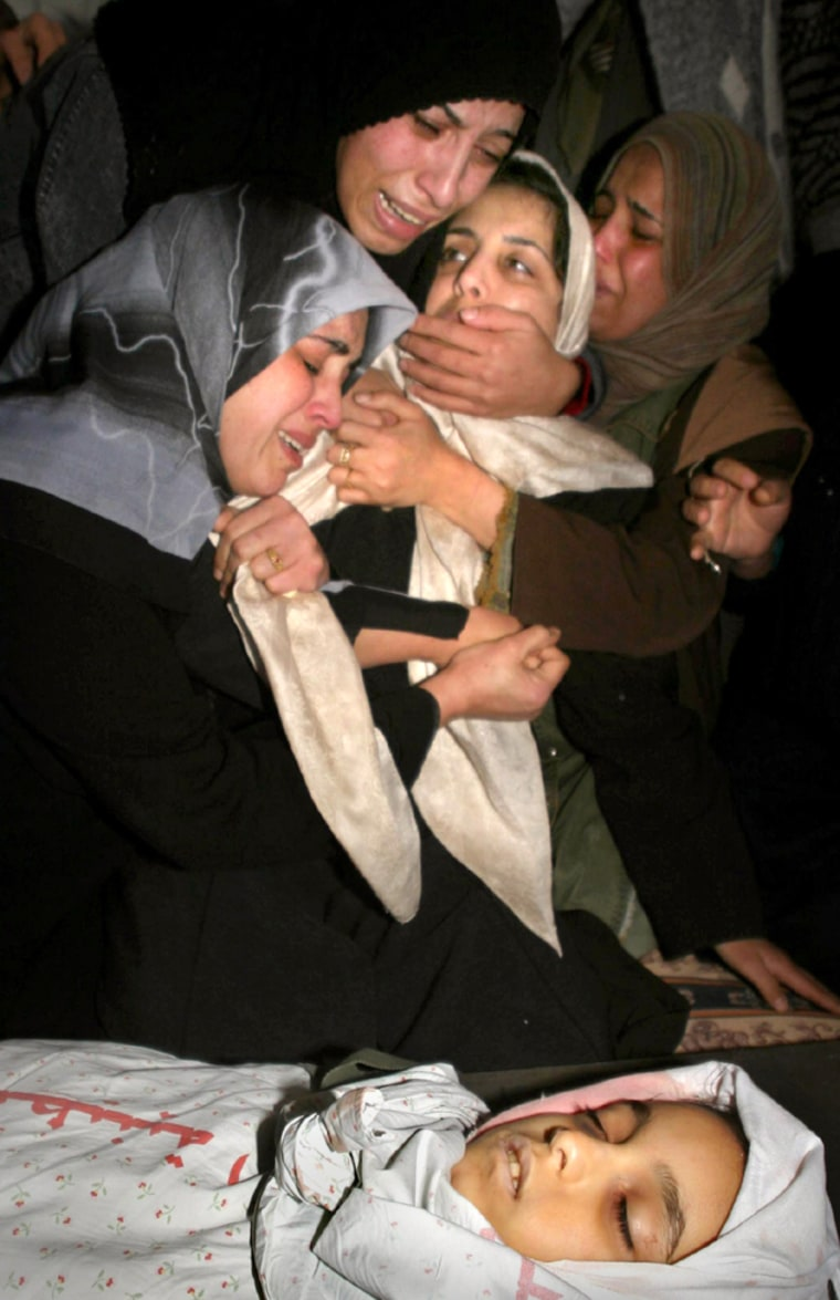 Palestinian women mourn the body of a 10-year-old girl brought home during her funeral in Rafah refugee camp
