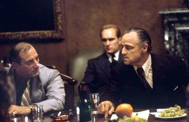 """Robert Duvall sits behind Marlon Brando, right,in this image from the 1972 movie """"The Godfather."""" Brando recorded voice-overs for the new game before his death last summer."""