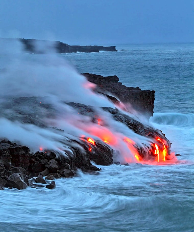 Fiery lava from Kilauea in Hawaii Volcanoes National Park enters the Pacific Ocean at dawn Wednesday.