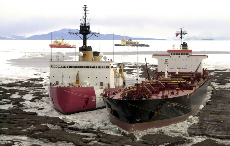 The U.S. Coast Guard icebreaker Polar Star, left, and the Navy tanker USNS Paul Buck are docked at the ice pier at McMurdo Station in Antarctica. In the background are the Russian icebreaker Krasin, at center, and the NSF research vessel Nathaniel B. Palmer.