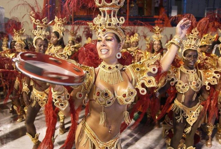 Dancers of 'Renacer de Jacarepagua' samba school participate during carnival celebrations Saturdayat the sambodromo stadiumin Rio de Janeiro.