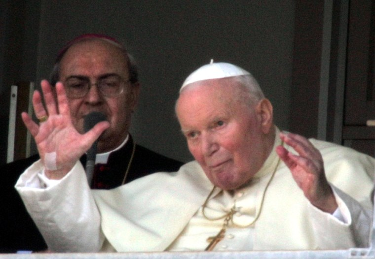 Pope John Paul II blesses the faithful from his suite at the Gemelli hospital in Rome on Sunday.