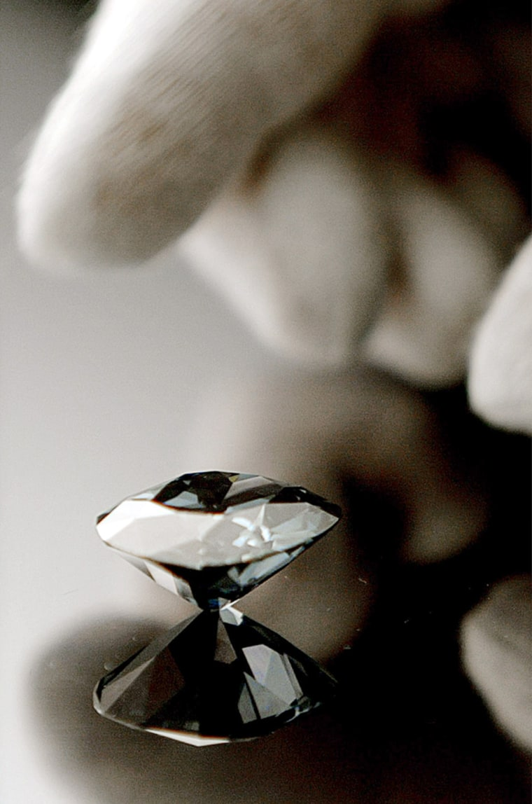 The Hope Diamond is placed on a mirror at the Smithsonian's Natural History Museum in Washington in this Oct., 2003 file photo.