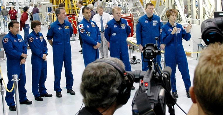 The crew of the upcoming shuttle mission faces reporters Thursday at NASA's Kennedy Space Center in Florida. From left are Charles Camarda, Wendy Lawrence, Stephen Robinson, Soichi Noguchi, Andrew Thomas, James Kelly and commander Eileen Collins.