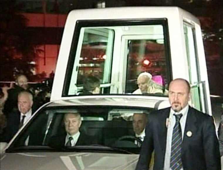Pope John Paul II rides back to the Vatican in the 'Popemobile' after leaving Rome's Gemelli hospital on Thursday.