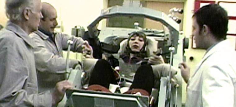 The Russian space effort's last woman cosmonaut, Nadezhda Kuzhelnaya, is prepared for centrifuge training at the Star City complex in 2001. Kuzhelnaya resigned from the cosmonaut corps last year without ever flying in space.