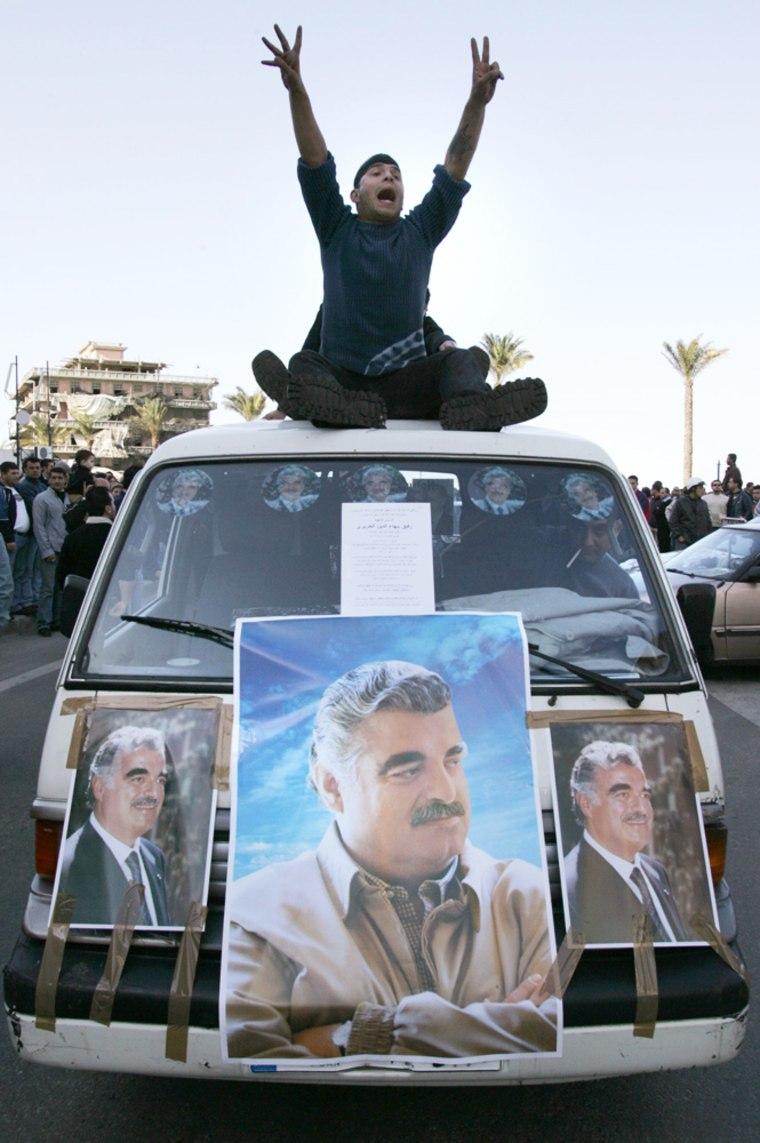 Supporters of slain formerPrime Minister Rafik Hariri ride through the streets of Beirut on Tuesday.