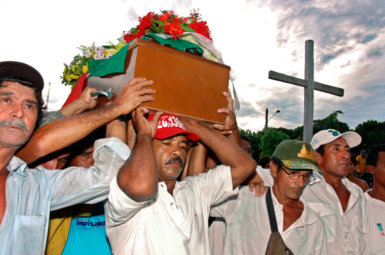The coffin of American missionary Dorothy Stang is carried through Anapu, Brazil, on Monday.