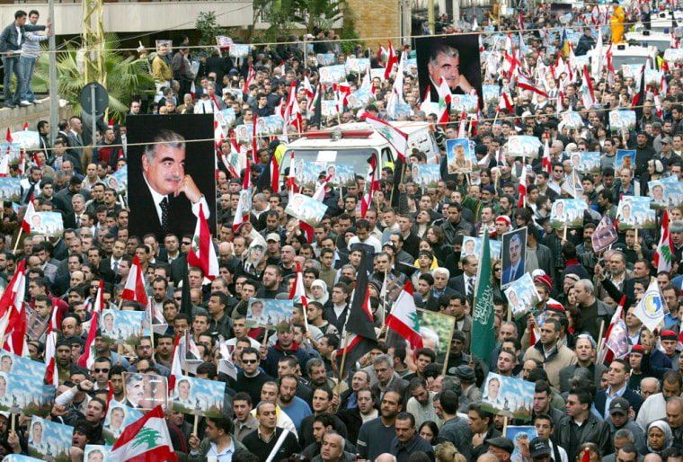Thousands of supporters of former Lebanese Prime Minister Rafik Hariri take part inthe funeral procession in Beirut onWednesday.